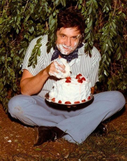 Johnny Cash, high in a bush eating cake. 1971