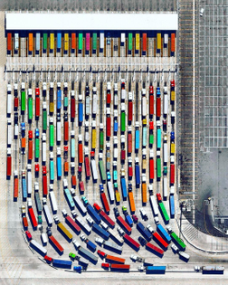 """""""Long-haul trucks wait in line to exit the Port of Los Angeles in California. It is estimated that there are approximately 3.5 million truck drivers in the United States and they drive nearly 140 billion miles on American highways every year. In total, 433 billion miles are covered annually by the entire population."""""""