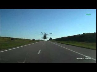 The helicopter is flying on the road for GPS navigator (Ukraine)