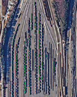 """Freight train cars, casting long shadows, are seen in at Inman Yard in Atlanta, Georgia, USA. The facility is operated by Norfolk Southern and serves as one of the major freight hubs on its network that extends for more than 36,000 miles (57,936 km) in the United States."""
