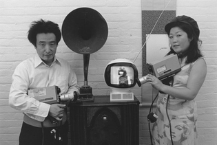 Nam June Paik and his wife, artist Shigeko Kubota, are shown in his New York studio in 1974.