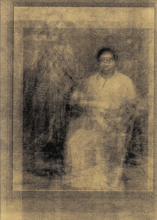 A golden image of what appears to be two ghostly figures, one seated and one standing behind. Everything is gold.