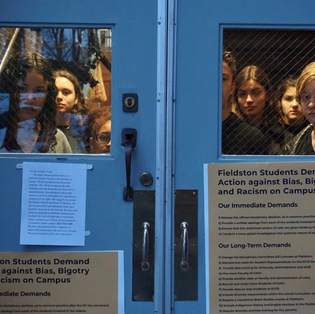 High school students lock out administrators in protest of racist video and stage an overnight sit in.