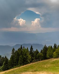 trees_and_clouds_with_a_hole-_karawanks-_slovenia.jpg