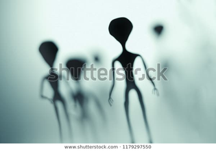 spooky-silhouettes-aliens-bright-light-600w-1179297550.jpg