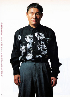 Takeshi Kitano wearing Comme des Garcons from 1991 '6.1 The Men'