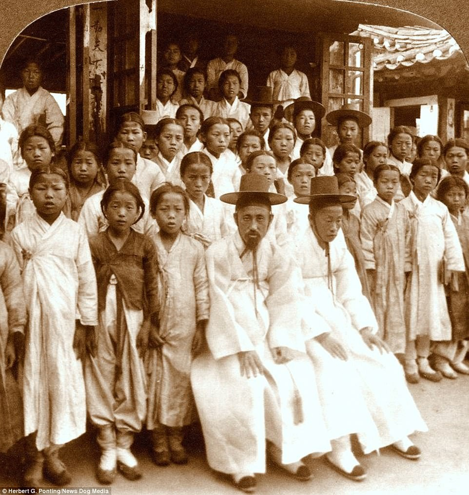School in Seoul, 1903 - these hats man...