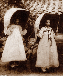 Two women are shown displaying basket fashion accessories in Seoul,1904