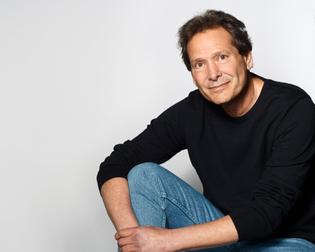 Sweater and jeans - Dan Schulman