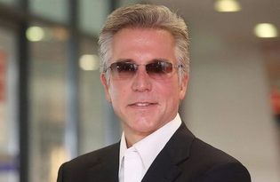 Suit no tie, sunglasses - Bill McDermott