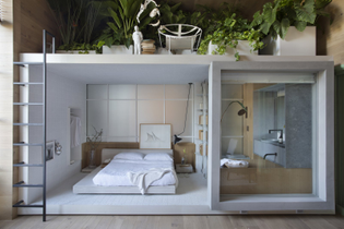 in-architect-nildo-joses-loft-ninho-a-bedroom-box-clad-in-ceramic-tile-rests-within-an-oak-wood-wrapped-space-creating-a-qui...