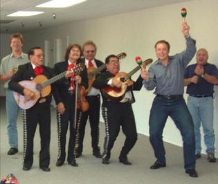 Elon Musk with Mariachi holding maracas