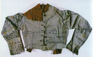 Linen jacket – Agnes Richter (1895), a seamstress who was incarcerated in an Austrian asylum during the late 1800′s and who embroidered her life story onto the jacket as an attempt to express her identity