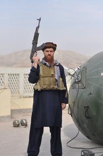 aid_worker_in_afghanistan_poses_before_inflatable_satellite_dish.jpg