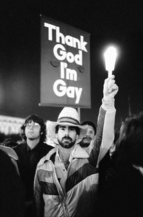 """""""THANK GOD I'M GAY,"""" Timothy Hough (foreground) and other activists, AIDS vigil, San Francisco, California, 1983. Photo by Crawford Barton."""