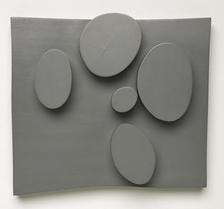 Hans Arp, Objects organized according to case law III (1931; oil on panel, 25.7 x 28.9 x 6 cm; San Francisco, San Francisco Museum of Modern Art)