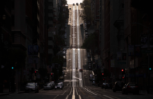 California Street in San Francisco, California, usually filled with cable cars, is seen empty on March 18, 2020.