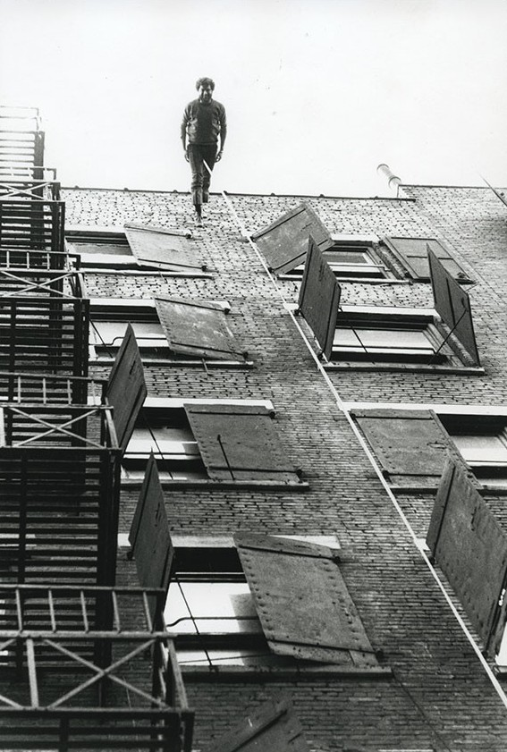 Trisha Brown, Man Walking Down the Side of a Building