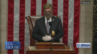 A congressman convenes the House — wearing mask and gloves.