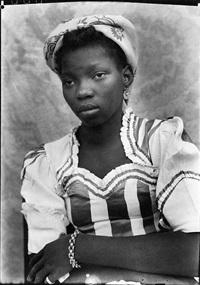 seydou-ke-ta-untitled-portrait-of-a-woman-with-folded-arms-1949-51.jpg