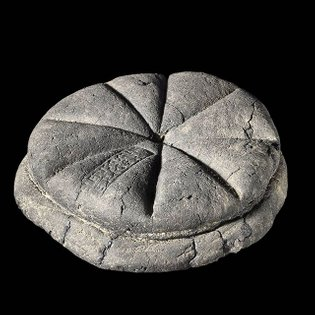 """Carbonized bread from Pompeii, complete with a baker's stamp, which reads """"Property of Celer, Slave of Q. Granius Verus"""", 79..."""