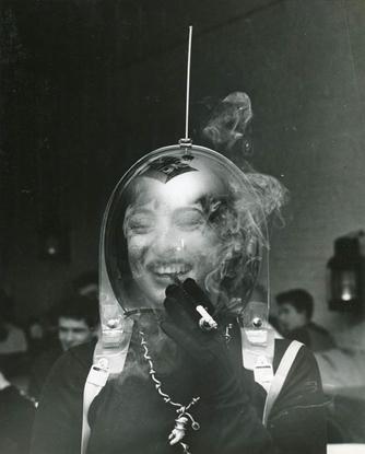 """𝚂𝙿𝙸𝚁𝙸𝚃 𝚁𝙴𝙲𝙴𝙸𝙿𝚃 on Instagram: """"""""Woman In Space Helmet Smoking a Cigarette"""", Weegee ca. 1950"""""""