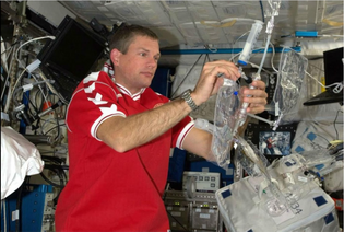 Andreas Mogensen in ISS testing Aquaporin water filters.png