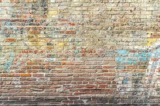 faded-graffiti-on-brick-wall.png