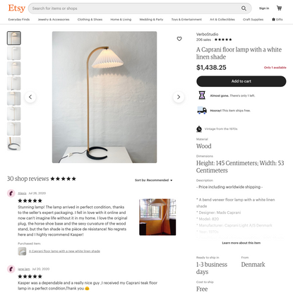 A Caprani floor lamp with a white linen shade