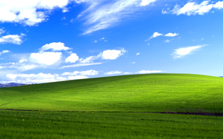 126274-nature-landscape-sky-hill-grass-field-clouds-windows_xp.jpg