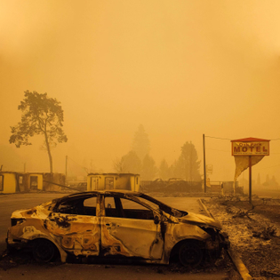 Historic fires across western US force evacuations, stretch fire crews, spawn misinformation