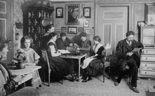 """Living room of a large family. Picture taken by the father via remote release."" Germany, 1900s"