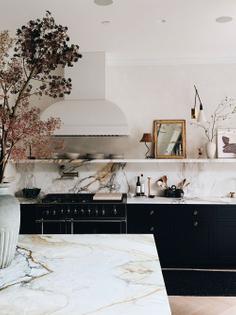 white-marble-shelf-over-kitchen-stove.jpg