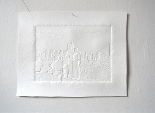 A blind-embossed piece of paper shows a detailed silhouette of my grandparents standing on ellis island in front of a view of the twin towers
