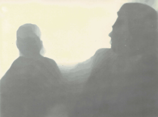 A lumen print of silhouetted figures. My uncle is speaking to my aunt.