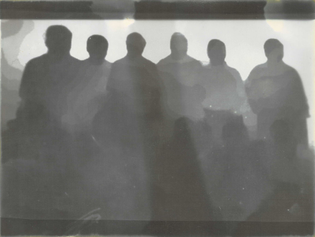A lumen print of several silhouetted figures. It is a group photo.