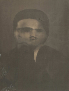 A sepia-toned lumen print of a machine generated image of what appears to be a man who's face is morphing into two faces.
