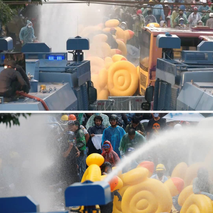 """redfish on Instagram: """"Thai anti-government protesters are using big inflatable rubber ducks to shield themselves from water..."""