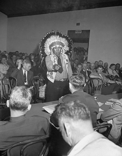 Indian Chief speaking to Army officers about the construction of Garrison dam. North dakota, 1946