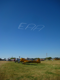 1280px-skywriting_over_airventure.jpg