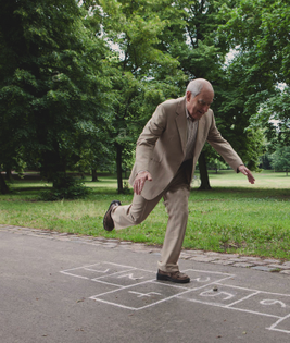 senior-man-playing-hopscotch-in-the-park-c7h24n-edit.jpg