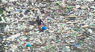 brazil-garbage-river-man-walk.jpg