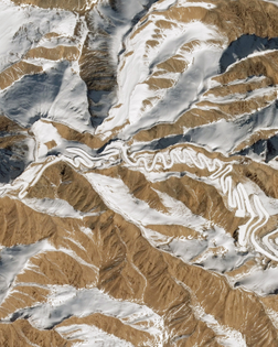 """""""This Overview shows a small section of the """"Panlong Ancient Road"""" in southwestern Xinjiang, China. Located near the Chinese border with Tajikistan, this route snakes for 47 miles (75 km) through the Pamir Mountains, rising 13,450 feet (4,100 meters) above sea level. Some reports claim it has more than 600 hairpin turns."""""""