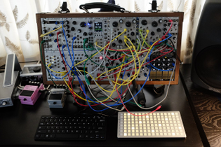 6U Eurorack Modular Synthesizer with patch cables and outboard devices