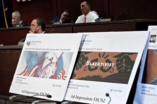 Displays showing social-media posts during a House Intelligence Committee hearing in 2017