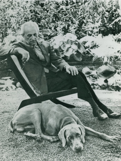 Henry Klumb sitting by his lily pond and garden.