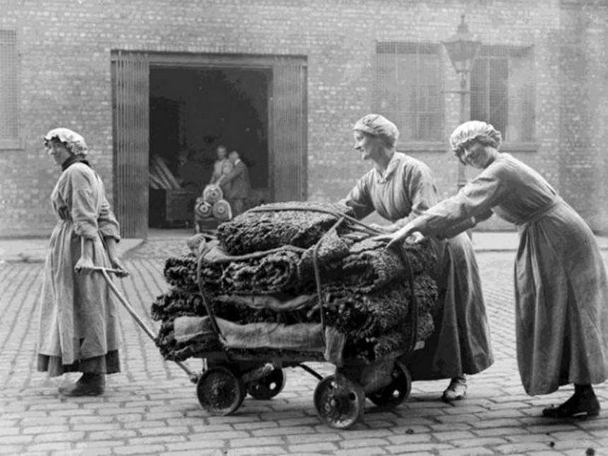 female-workers-tow-a-trolley-of-raw-rubber-from-a-warehouse-at-the-factory-of-charles-macintosh.jpg
