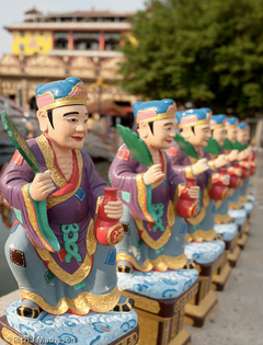 Colorful Jigong (Drunk Monk) statues with fans and liquor gourds in Cishan