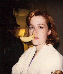 Gillian Anderson with a banana in her nose on the set of The X-Files, 1990s