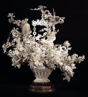 A Japanese intricate ivory sculpture of a basket of flowers. Meiji period, circa 1900